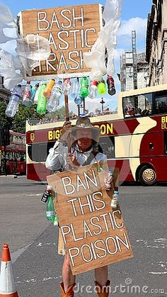 A man protesting against single use plastics in London, England.