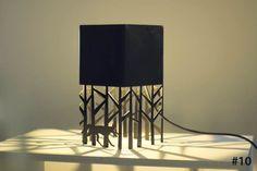 Florencia Vivas: Serie Selva. Luminarias realizadas en chapa calada.