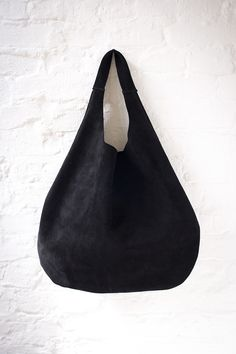 Black simple leather shoulder hobo bag. Soft suede leather.  No lining,no internal pockets.  Simple all day large bag .    -soft italian leather