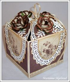 Nice, brown box....with four roses on the lid. #boxes