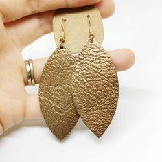 Bronze leaf leather earrings, leather lightweight earrings, nickel free hypoallergenic earrings, copper leather earrings, leaf cutout by SimplyStrandedDesign on Etsy https://www.etsy.com/listing/552492771/bronze-leaf-leather-earrings-leather