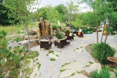 "The large stones in the back patio are Colorado buff flagstones, with thyme, Turkish veronica and sedum growing around them. Scott Deemer used a tumbled concrete paver product for the other patio stones, and inset them ""to give the space a more artistic mosaic."" (photo by Scott Deemer, courtesy Outdoor Craftsmen)"