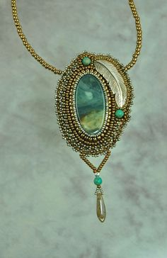Bead-embroidered pendant by Sue Horine