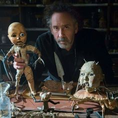Tim Burton with Enoch's dolls ~ on the set of MISS PEREGRINE'S HOME FOR PECULIAR CHILDREN. Photo by Leah Gallo