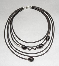 Playful Black Necklace by Dagmara Costello. Elegant, black onyx beads with very unique polish are accented with sterling silver. This asymmetrical five strand rubber necklace is finished with easy-to-use magnetic clasp. Black Necklace, Stone Necklace, Pearl Necklace, Jewelry Art, Jewelry Necklaces, Jewelry Ideas, Jewlery, Silver Pearls, American Jewelry