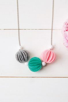 DIY jewellery: How to make a pom pom necklace - Mollie Makes