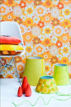 Retro Villa wallpaper plus lampshades, chair and cushion arrangement