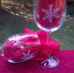 Snowflake hand painted wine glasses by GlassesbyJoAnne on Etsy, $40.00