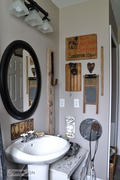 Eclectic bathroom wall / A little new old upcycled bathroom organizing via http://www.funkyjunkinteriors.net/