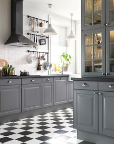 #Checkered floor and gray #cabinetry make the silver #knobs pop