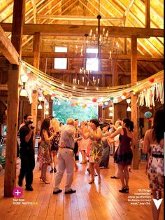 streamers and poms, maine barn wedding