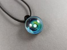 Handblown glass galaxy pendant for women and men, Silver fumed Borosilicate space necklace, with a floating opal planet, Space Pendant Green Earrings, Hand Blown Glass, Glass Pendants, Black Suede, Sterling Silver Earrings, Necklace Lengths, Opal, Stainless Steel, Pendant Necklace