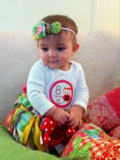 My little Madeline 8 months- I made her fabric flowered & buttons headband and scrap fabric tutu.  Kreativekatiekonnect@gmail.com