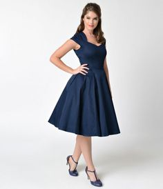 Dance delightfully in this Pin-Up classic! A navy blue sweetheart swing dress with a charming retro shape that boasts a slim-fitting bodice, princess seamed sweetheart neckline with cap sleeves and ample full circle skirt with hidden side pockets, this st