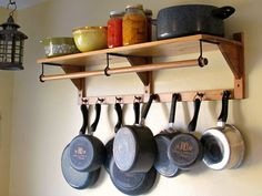 hanging pots and pans in kitchen | LOVE my Paula Deen pots and pans.
