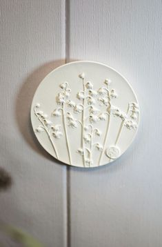 Spring Lilies of the valley plaster wall art for flowers lovers by DinaArtDecor. Rustic round wall decor as herbarium sculpture. Foyer botanical bas relief. The botanical panel is ideal for decorating the entrance hall, living room, kitchen, bedroom or baby room. You can combine several bas-reliefs into one composition. These panels are an amazing gift for nature lovers #vintagewallart #diningroomdecor #artwork