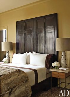 Antique doors were joined to make the master bedroom's headboard in the Manhattan penthouse of two fashion executives.