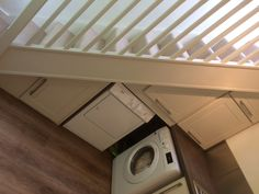 My under the stairs cupboards, tumble drier and washer