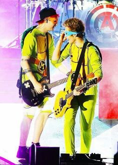 Michael and Luke>>>> I love that they actually performed in the ninjas turtle onesies, but what I love even more is that they actually take the onesies on tour with them!! It's adorable!!!