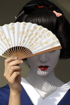 Japanese Geisha, I love the contrast between her made up face and natural hand.