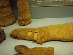 Knitted wool stocking, 16th/17th c, excavated in Copenhagen. Note the cb 'seam' (k one row, p2, k1, p2 second row); common heel; a few decreases towards toe. Danish National Museum