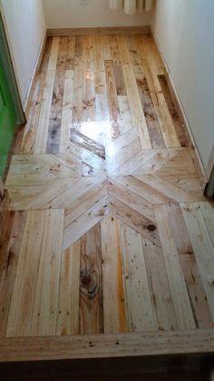 Pallet wood flooring httphgtvdecordiy ideaspallet shipping pallets floor small cottage hallway with star feature wood mosaic cottagelife solutioingenieria Gallery