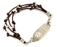 Four thin strands of leather are tied in knots in this medical bracelet. Separating the knots are base metal silver colored beads. Your bracelet will attach to the medical plate with stainless steel clasps.  This medical bracelet comes with an optional medical heart charm or round charm option, see pull down menu to choose this option. These optional medical charms will not be engraved.  http://www.stylishmedicalid.com/