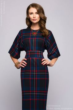 Rich plaid dress with raglan sleeves and nipped-in waist.