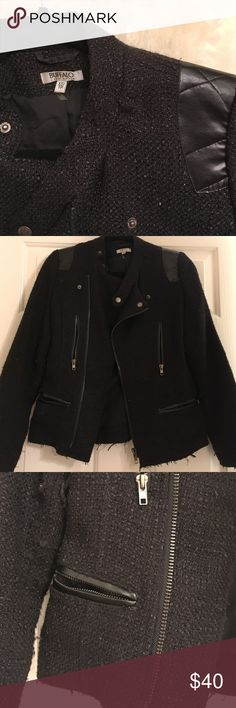 Black Chanel type jacket Black Lines jacket with 4 zip pockets and zip up front. Button Lapels and leather shoulder detail. Excellent condition. Only wore a couple of times. 100% polyester outer and the lining is 65% polyester and 35% cotton. has the look and feel of Chanel jackets. Great staple niece for any closet. Tag says size XS but I believe will fit a small comfortably. Ask for measurements of you are interested.  No trades Buffalo David Bitton Jackets & Coats Blazers
