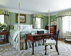 Master Bedroom in Soothing Greens  Sage-green walls in this bedroom establish the color palette. The classic four-poster bed is dressed in layers of mossy and minty hues. A needlepoint rug with green accents grounds the space.  Interior design: Jack Fhillips