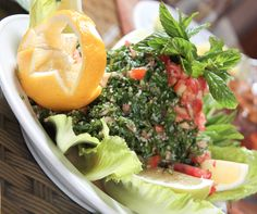 Arab salad  - 1\2 cup crushed wheat (Borghol)  - 3 bunches of parsley  -  4- 6 tomatoes   - 2 large white onions  - 1\2 cup olive oil  - Juice of 3 lemon or to taste  - white pepper