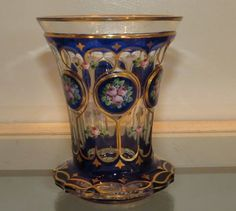 Unusual Antique Blue Overlay Moser Enamel Glass Beaker which dates to the mid 19th century.It is a very fine example in gilt and enamel decorated blue overlay glass.