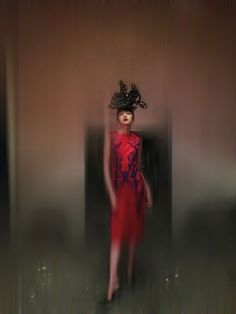 Hat - Philip Treacy and Simon Periton, A/W 1999. Cut out anarchy symbol hat, foam. Dress — Tristan Webber, S/S 2000. Red silk dress with blue appliquéd leather detailing, silk and leather. Shoes — Manolo Blahnik. Model: Xiao Wen Ju at IMG. © Nick Knight. http://www.yatzer.com/isabella-blow-fashion-galore-somerset-house