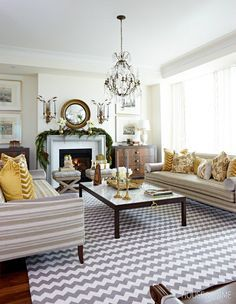 The Horizontal Striped Sofa Invigorates The Formal Space And Warm Gold Accents Tie The Whole Scheme Together Photographer M Home Home Decor Beautiful Space