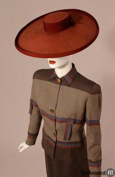 1940s Adrian suit - note how the line has been continued across the shoulder. Divine. And the hat is wonderful.