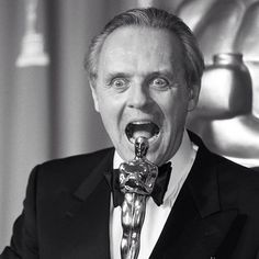 "Anthony Hopkins sizes up his award for ""Silence of the Lambs"" at the 1992 Oscars."