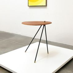 Anonymous; Teak, Enameled Iron and Brass Occasional Table, 1950s.