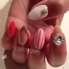 Gel nails -- stiletto -- gold -- studs