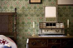 """Wightwick Manor: The Daisy Room at Wightwick Manor, Wolverhampton, West Midlands. The William Morris """"Daisy"""" wallpaper is original, & the bed is late Victorian & has cane panels at head and foot."""