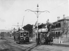 Duncan & Fraser trams;an old horse drawn tram being passed by a new 'B' type electric tram on Hackney Rd,Adelaide in South Australia in 1909.     •State Library of South Australia•