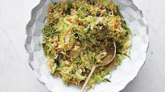 Shaved brussels sprouts heat up and sparkle with dried chile and Meyer-lemon juice. Quinoa and walnuts make the salad hearty.