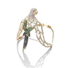 Parrot armlet in yellow gold with emeralds, sapphires and diamonds from Farah Khan's new Le Jardin Exotique collection.