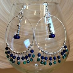 Lapis lazuli and malachite hoop earrings These are made with natural lapis lazuli and malachite beads   The ear wires are 925 Sterling silver. Handmade by me NWOT. They hang 3 inches Jewelry Earrings