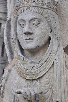 Queen Column Figure seen wearing a couverchief