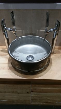 Sink made from old beer keg with beer taps. Love it!
