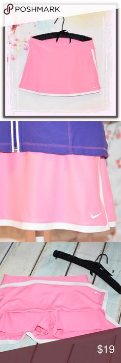 💗Pretty in Pink NIKE Skort💗 Love, love, love this pink in NIKE's line of active wear! This skort is in excellent like-new condition. She will be a go to piece when you want to feel comfortable and cute active or not so active. It measures 31 inches across the top and 13 inches in length. Ready, set, go... you will treasure her for sure❣️ 🌐consigning.fun/2kmat8228🌐 Nike Shorts Skorts