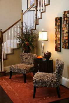 wall color, stair treatment, baseboard -- This would look good in Mother's foyer.
