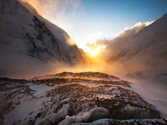 Sunset, Mount Everest - The sun sets over the west shoulder of Mount Everest (right) and Mount Nuptse Photograph by Cory Richards, National Geographic