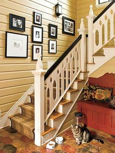 The newel finials on the mudroom staircase are based on chess pieces, and a paneled wall serves as the perfect place for black-and-white family photos. (Photo: Laurey W. Glenn)