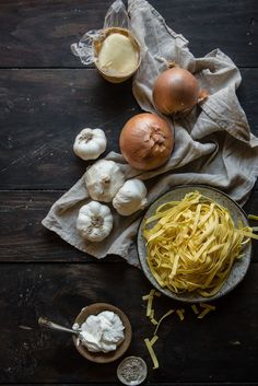 caramelized onions & roasted garlic pasta   two red bowls